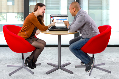 Male and Female Meeting Via Online Dating at a Coffeeshop stock photo