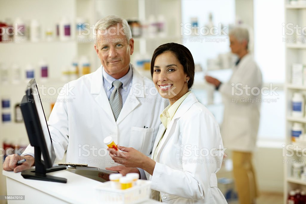 Male and Female Pharmacist stock photo