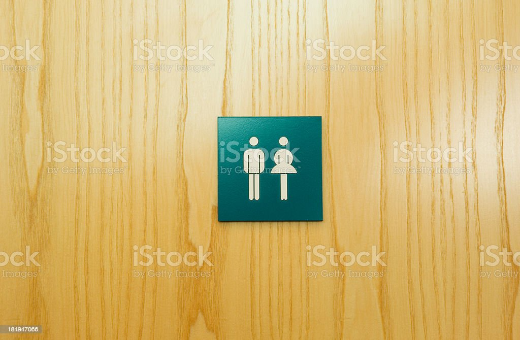 Male and female toilet sign on door stock photo