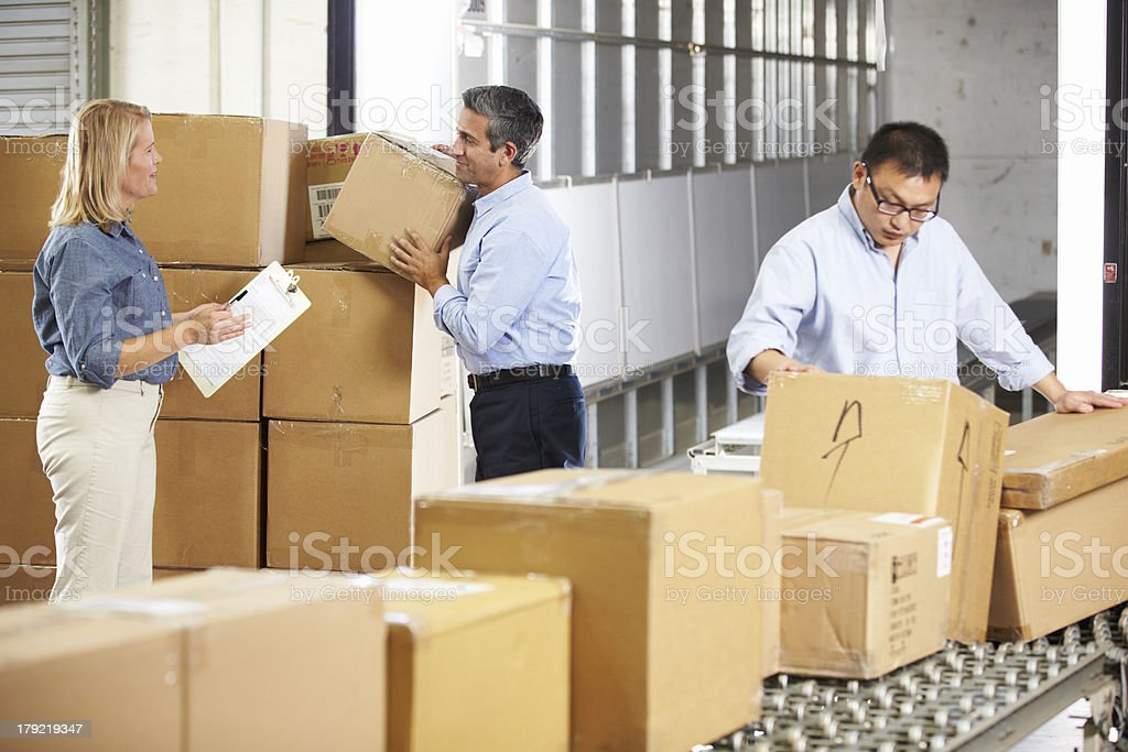 Male and female workers at distribution center royalty-free stock photo