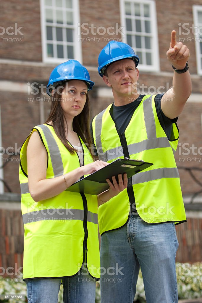 Male and female young construction engineers royalty-free stock photo