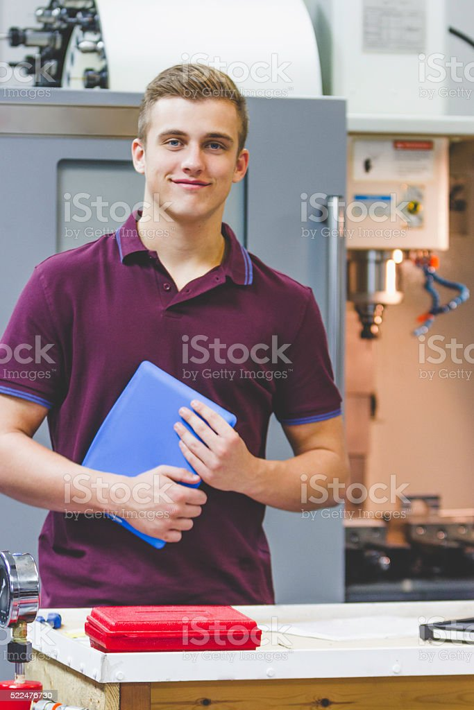 Male Apprentices in the Workplace stock photo