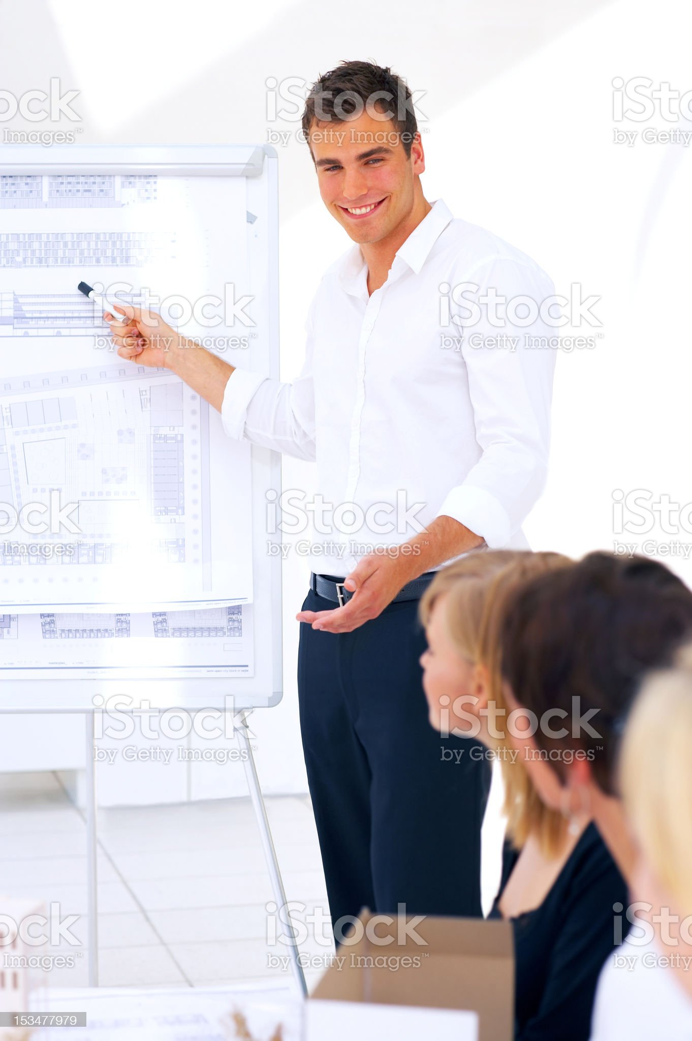 Male architect giving a presentation royalty-free stock photo