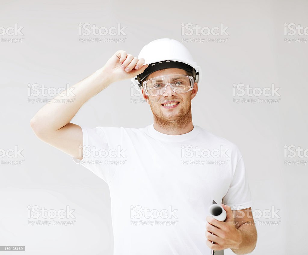 male architect in helmet with blueprint royalty-free stock photo