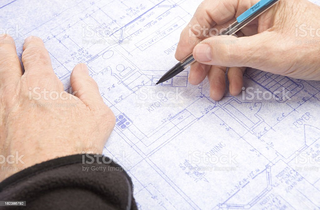 Male Architect's Hand Holding Mechanical Pencil on a Residential Blueprint royalty-free stock photo