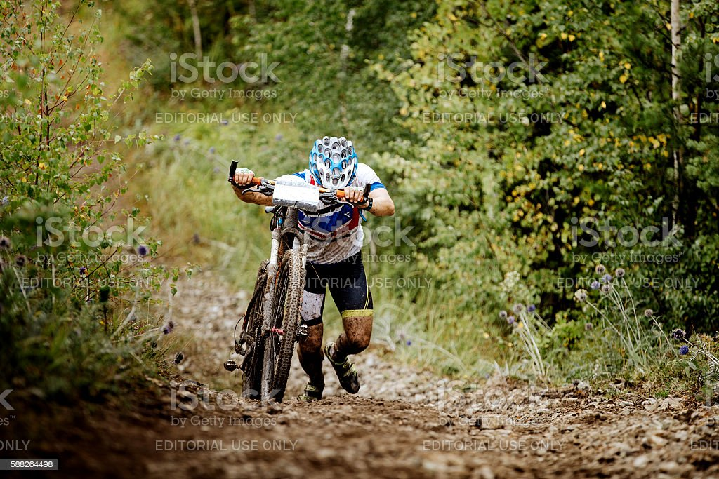 male athlete a cyclist walking uphill royalty-free 스톡 사진