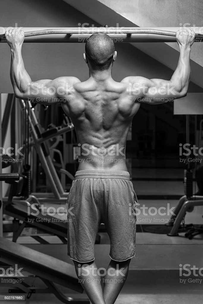 Male Athlete Doing Pull Ups stock photo
