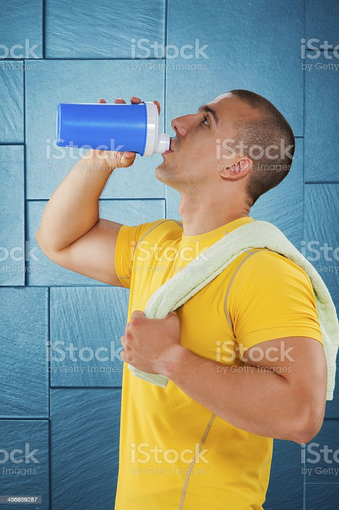 Male athlete drinking protein royalty-free stock photo