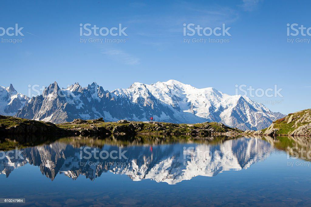 Male athlete enjoys a run in the French Alps stock photo