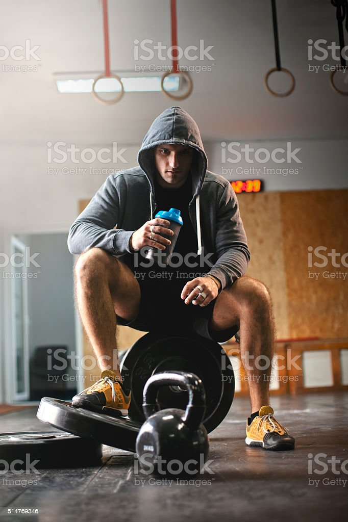 Male athlete enjoys delicious health drink stock photo