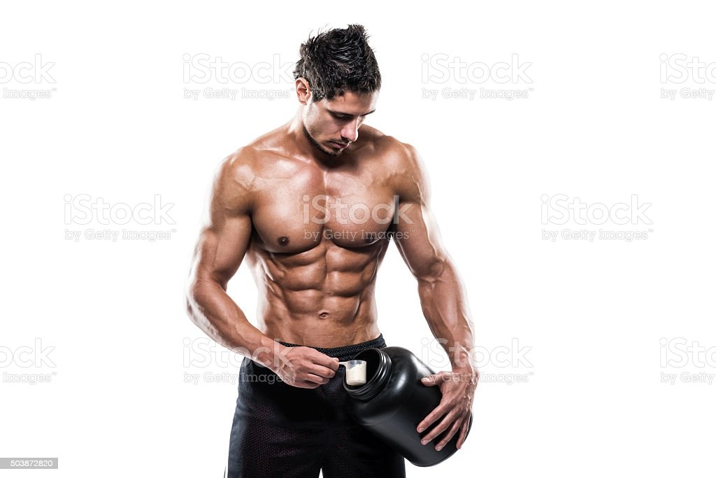 Male athlete holding bottle with supplement powder stock photo