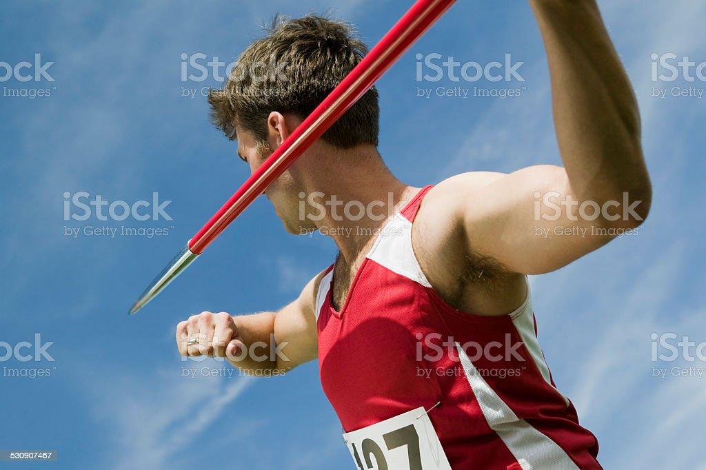 Male athlete holding javelin stock photo