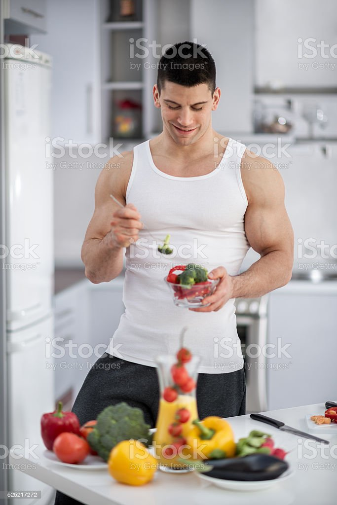 Male athlete in the kitchen stock photo