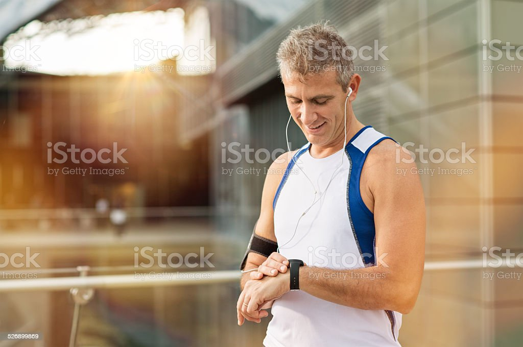 Male Athlete Looking At Watch stock photo