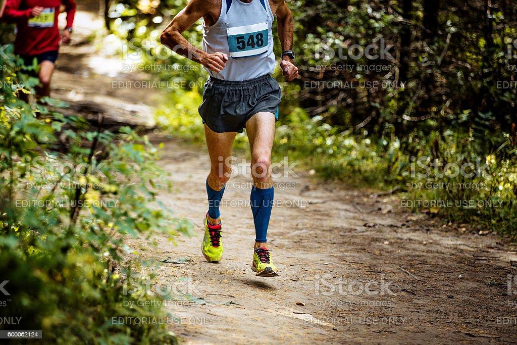 male athlete marathon runner running trail in woods royalty-free 스톡 사진