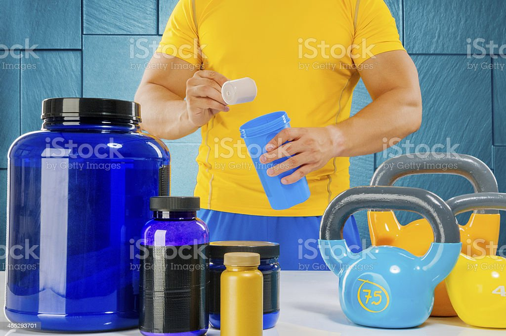 Male athlete mixing proteins royalty-free stock photo