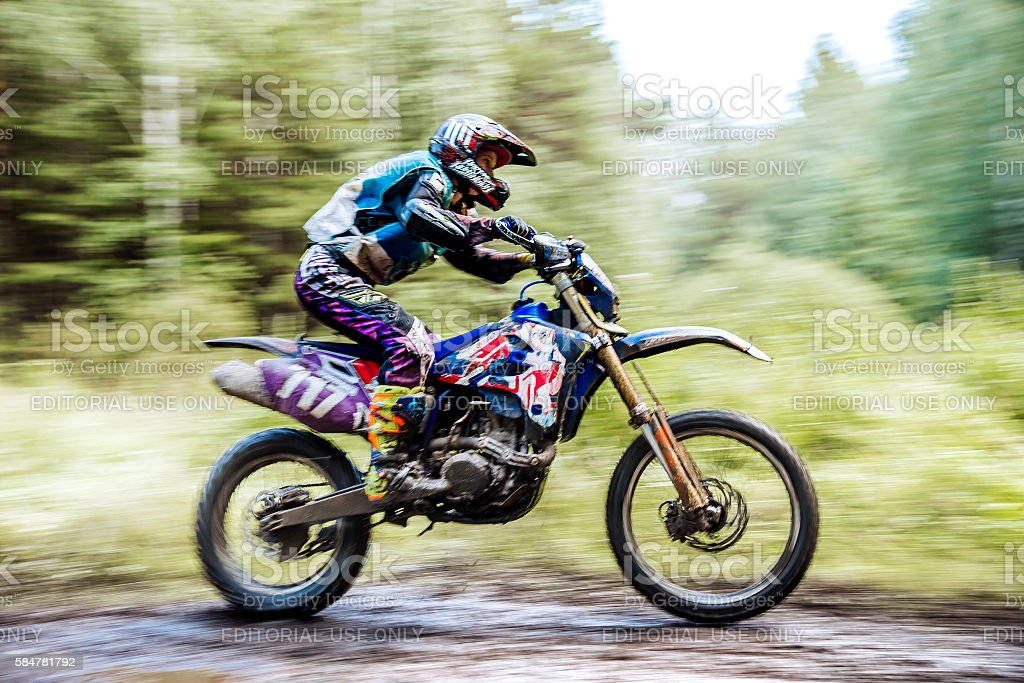 male athlete motorcycle racer rides in woods royalty-free 스톡 사진