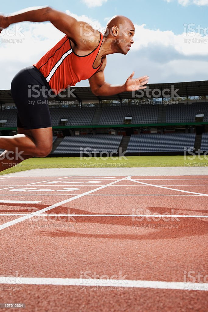 Male athlete on starting line of running track royalty-free stock photo