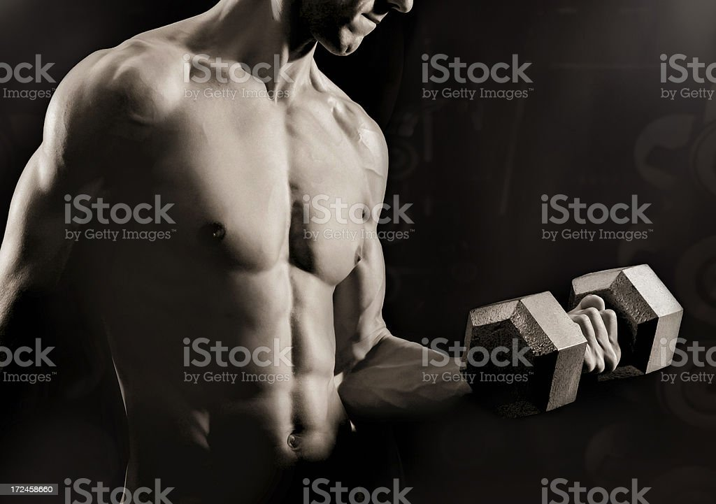 Male athlete performing bicep curl royalty-free stock photo