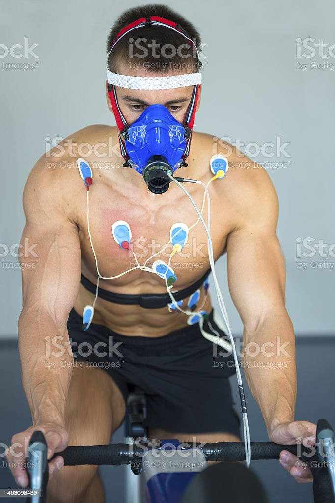 Male Athlete Performing ECG and VO2 test on Indoor Bicycle royalty-free stock photo