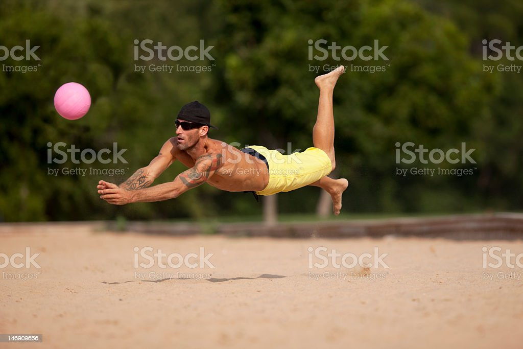 Male Athlete Playing Sand Volleyball royalty-free stock photo