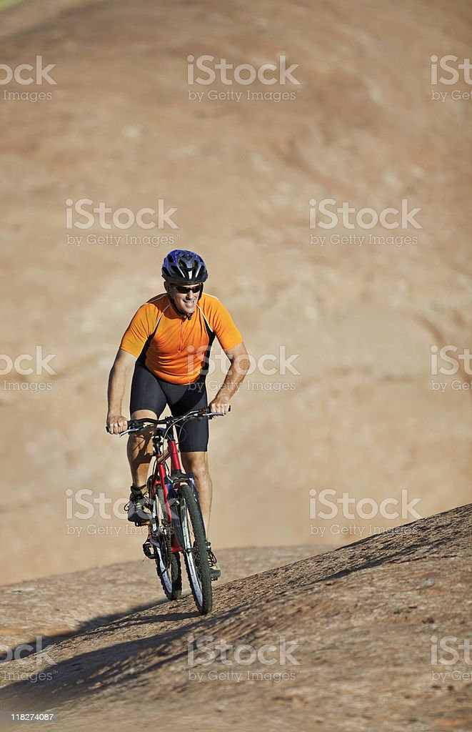 Male Athlete Riding Mountain Bike On Slickrock Trail, Utah royalty-free stock photo