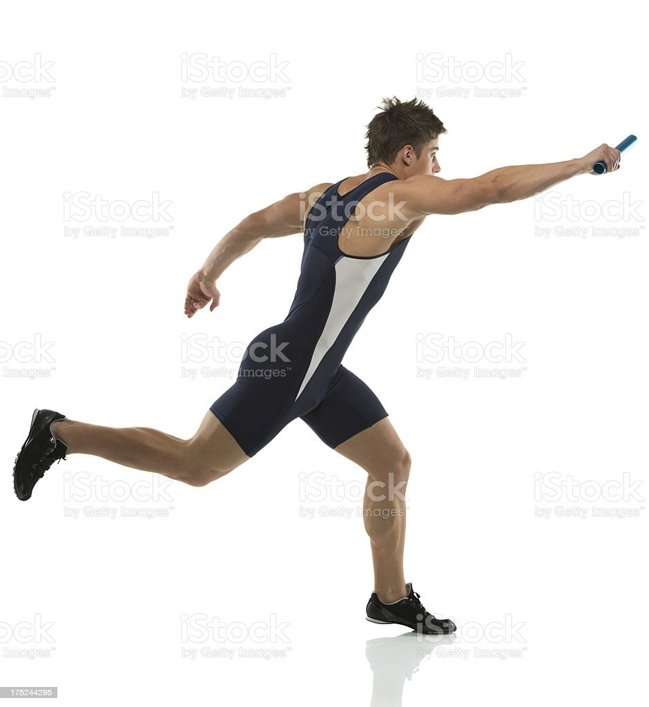 Male athlete running in a relay race royalty-free stock photo