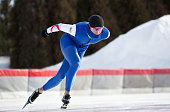 Male Athlete Speed Skating on a Cold Winter Day.