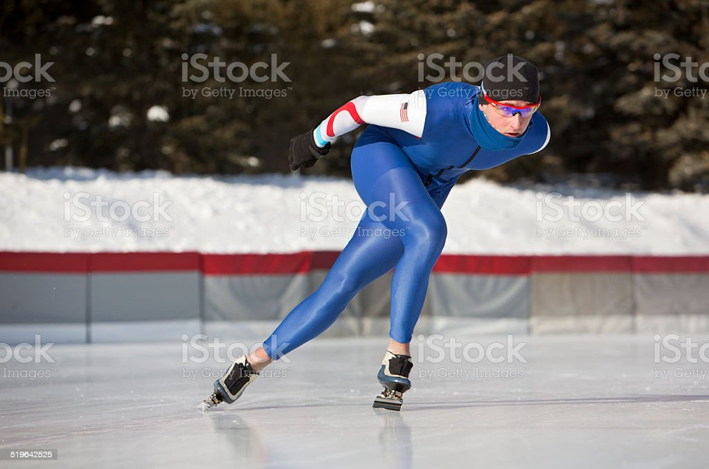 Male Athlete Speed Skating on a Cold Winter Day. stock photo