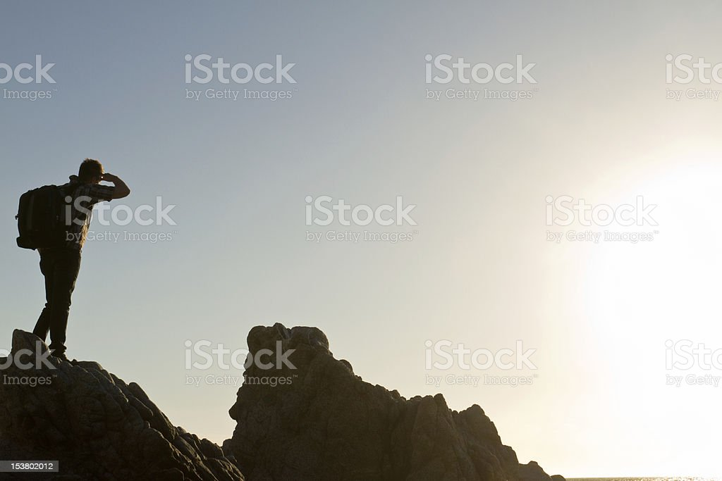 Male Backpacker at Rocky Beach royalty-free stock photo