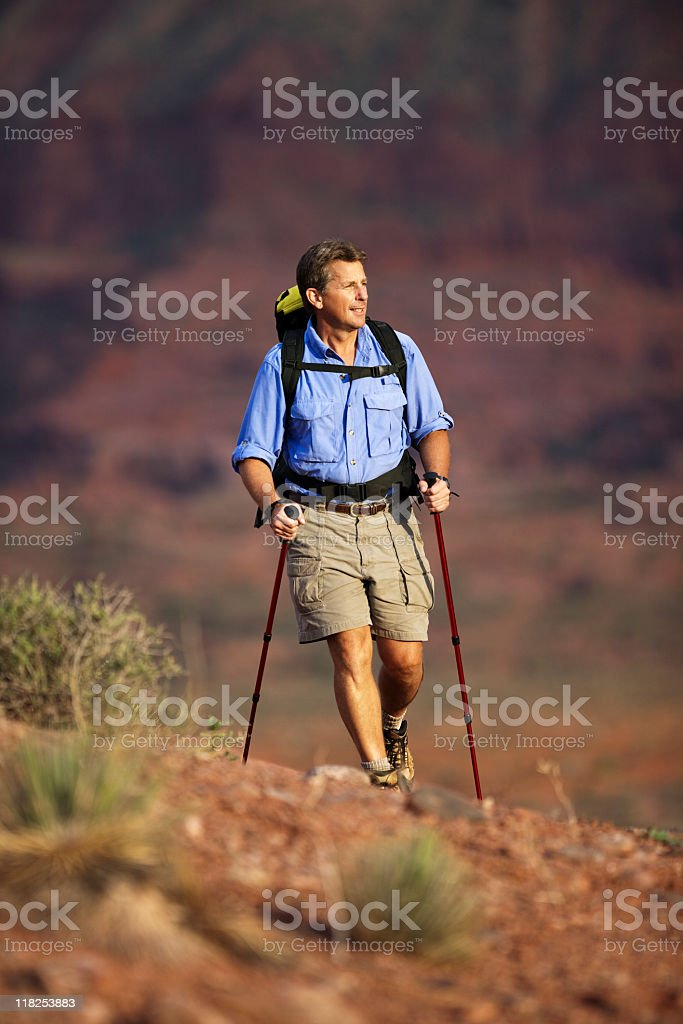 Male Backpacking Through The Desert In Moab stock photo