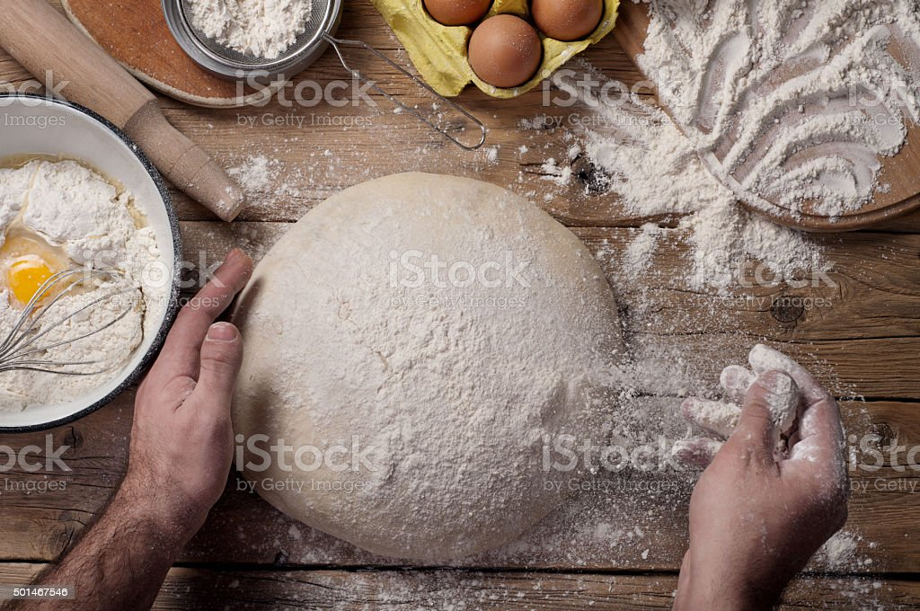 Male baker prepares bread stock photo