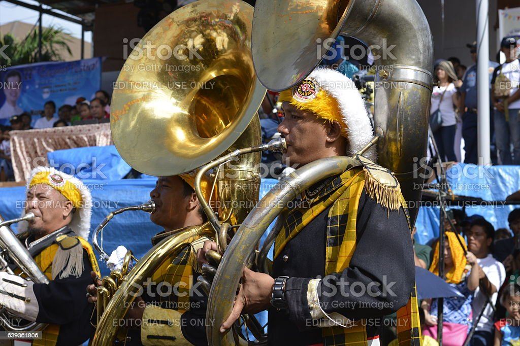 Male band member play bass horn on street exhibition stock photo
