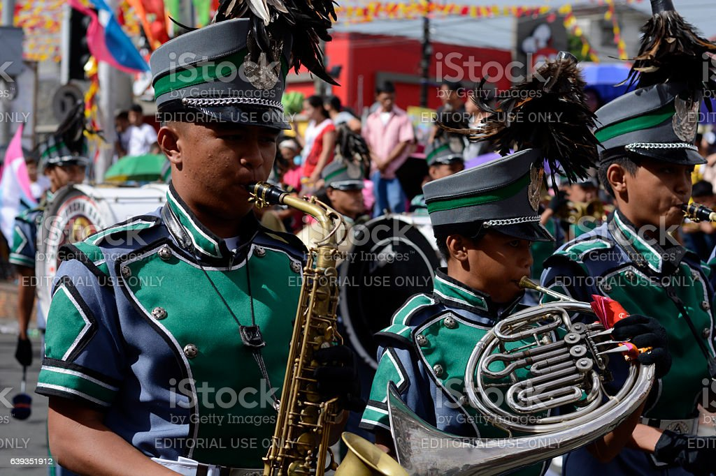 Male band member play saxophone at street exhibition stock photo