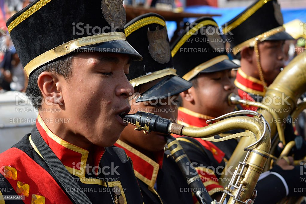 Male band member play saxophone on street exhibition stock photo