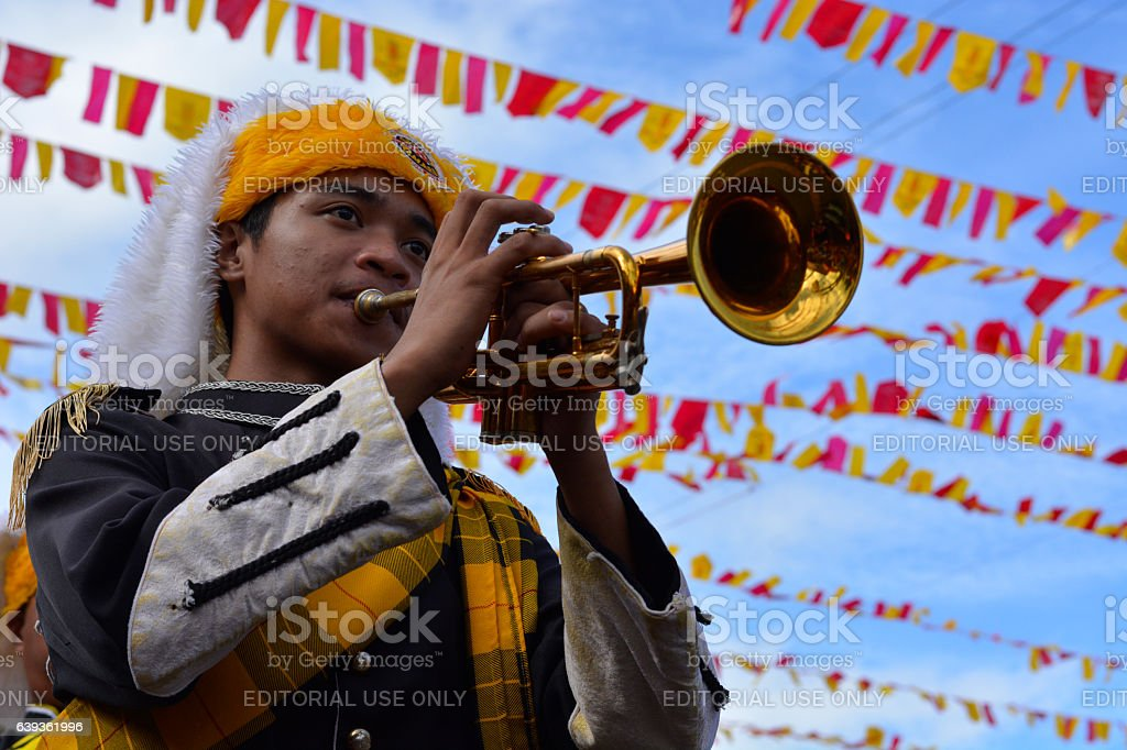 Male band member play trumphet at street exhibition stock photo