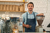 Male barista working in coffee shop
