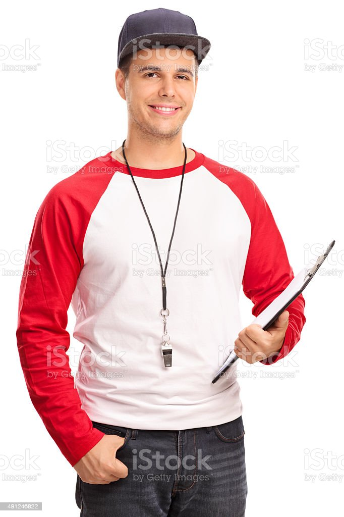 Male baseball coach holding a clipboard stock photo