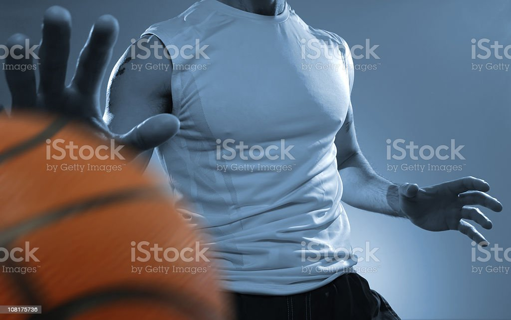Male Basketball Player Bouncing Ball royalty-free stock photo