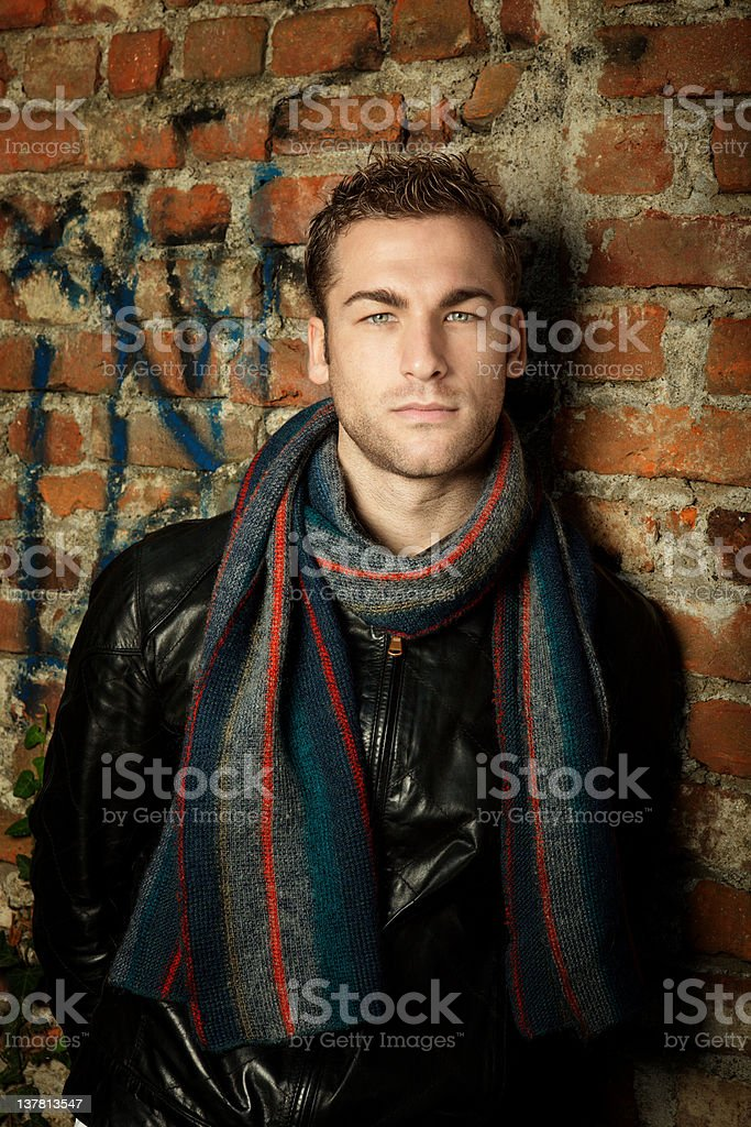 Male Beauty Portrait with Wall Background. Color Image stock photo