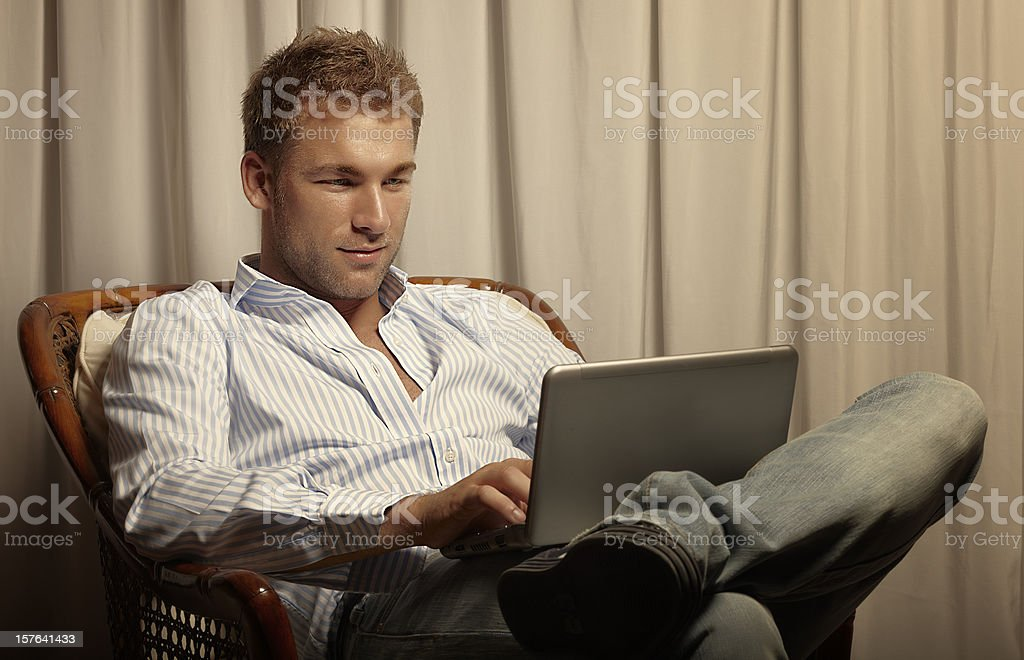 Male Beauty Use a PC. Color Image royalty-free stock photo