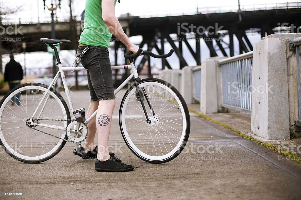 Male Bicycle Rider Breaks and Holds his Bike Still stock photo