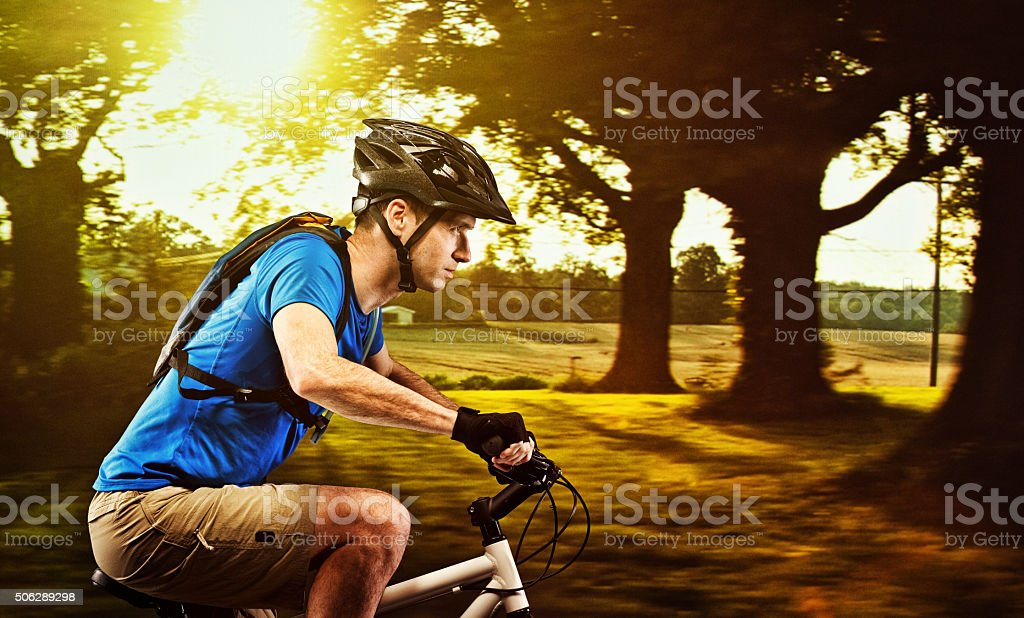 Male biker biking outdoors stock photo
