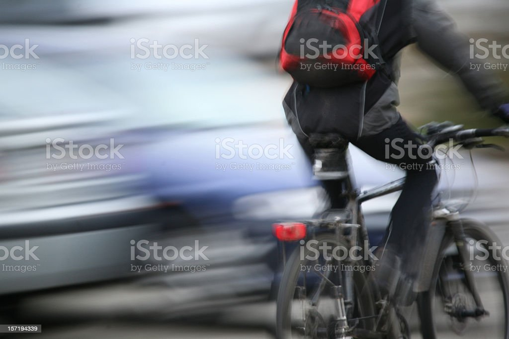 Male biker passing by in rush hour stock photo