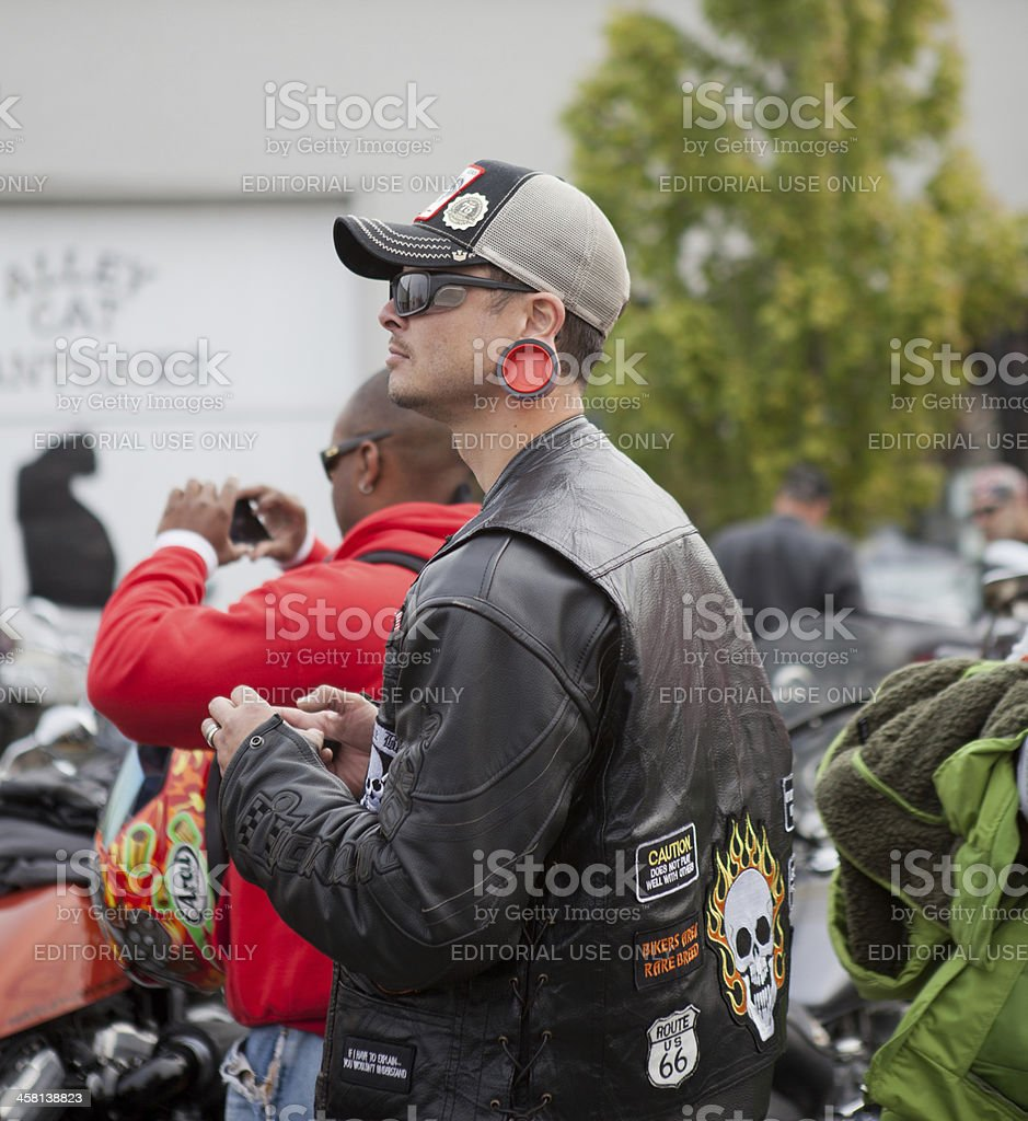 Male Biker With Large Ear Ornament at Oyster Run 9-23-12 stock photo