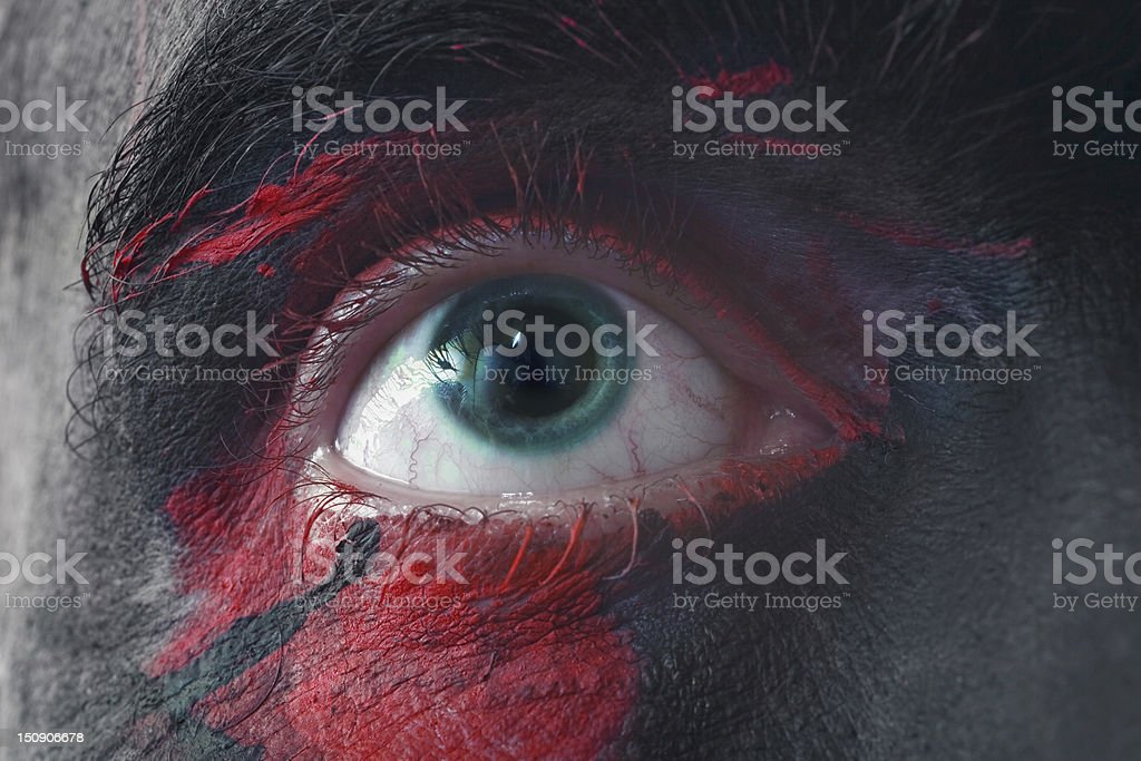 Male blue eyes bright with war paint royalty-free stock photo