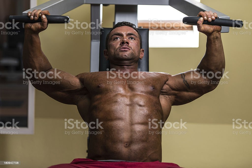 male bodybuilder doing heavy weight exercise for upper chest royalty-free stock photo