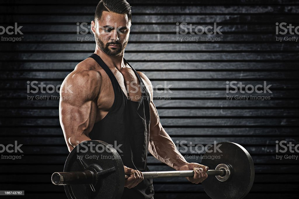 Male bodybuilder exercising with barbell royalty-free stock photo