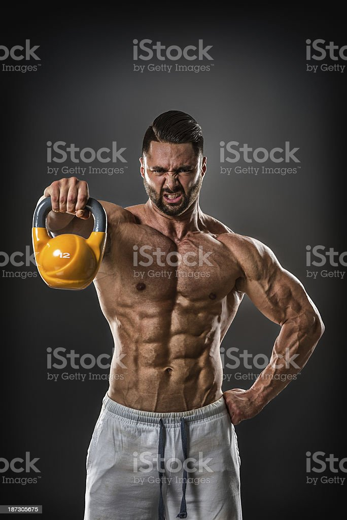 Male bodybuilder exercising with kettlebell royalty-free stock photo