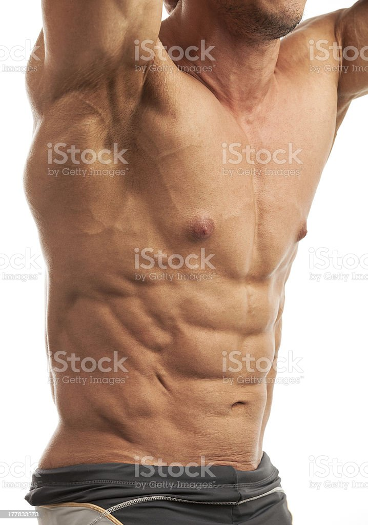 Male bodybuilder flexing his muscles royalty-free stock photo